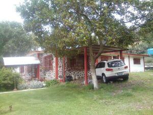 HERMOSA VISTA Y TRANQUILIDAD. Vendo casa de campo en La Purificación, Texcoco. 1245 metros cuadrados, 245 de construcción, una planta. 4 recámaras, sala, comedor, cocina, 2 baños, tanque estacionario, suficiente agua y hermoso jardín. Precio a tratar.   2,500,000   Teléfono 5511748325